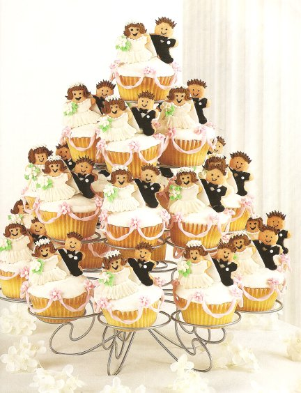 Bride and groom cupcake display