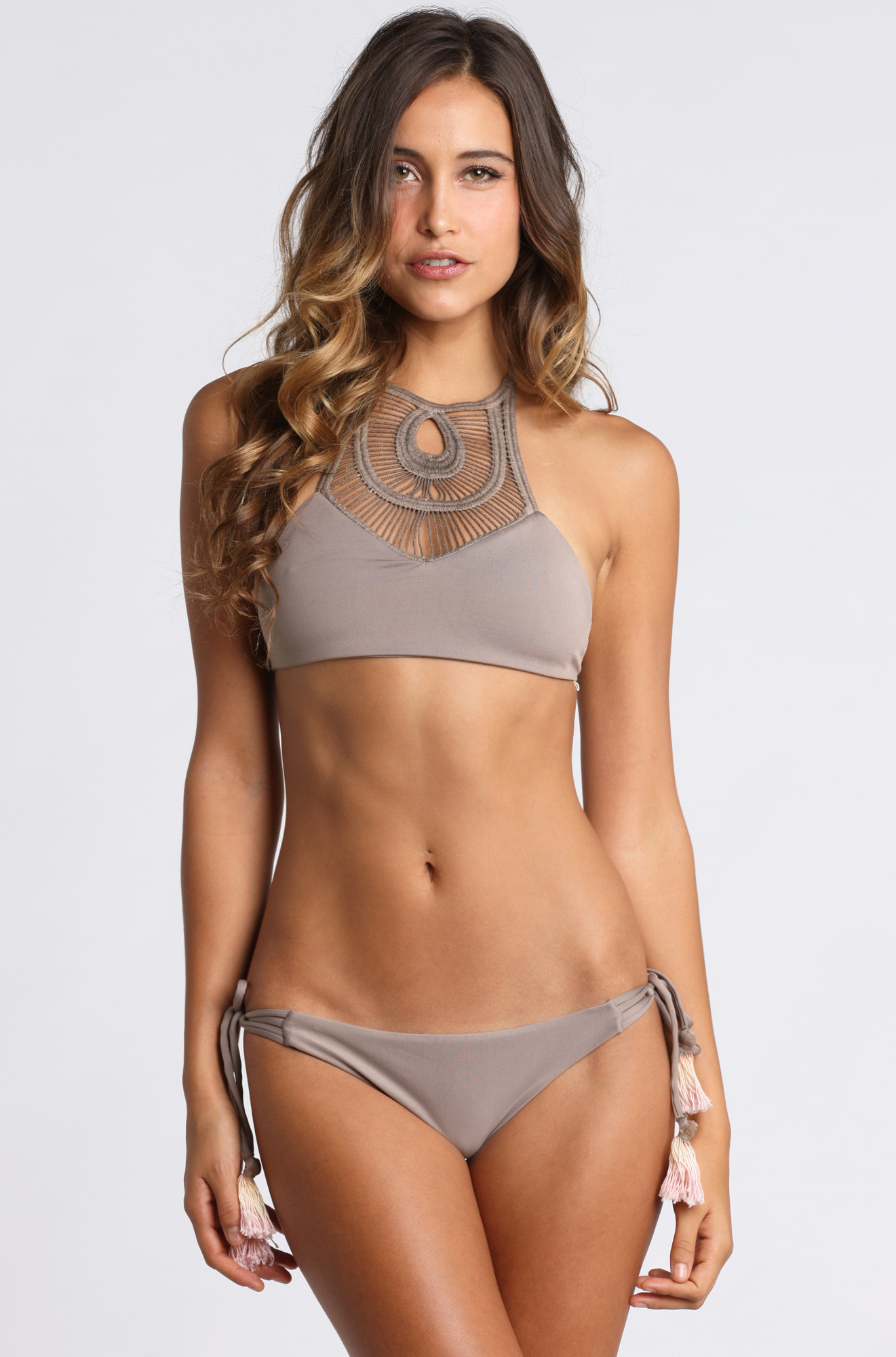 Designed for our surf athletes, these low-rise, minimal-coverage bikini swimsuit bottoms are reversible and have narrow straps that wrap around the front of the suit; they fit straight across the hips, and the body fabric is made of a soft and durable 83% recycled nylon/17% spandex blend. the Nanogrip Nireta Top is a supportive, athletic.