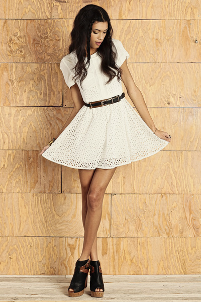 White dress with a black belt