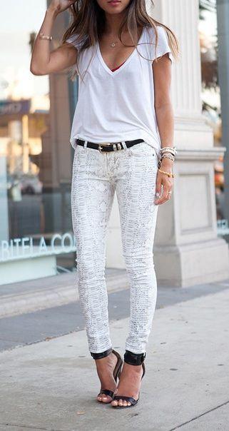 White snakeskin print pants