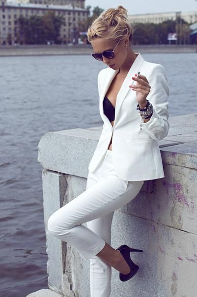 White suit with a black bra