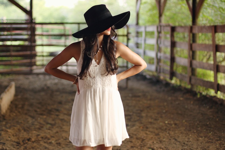 Floppy hat with white sleeveless mini dress