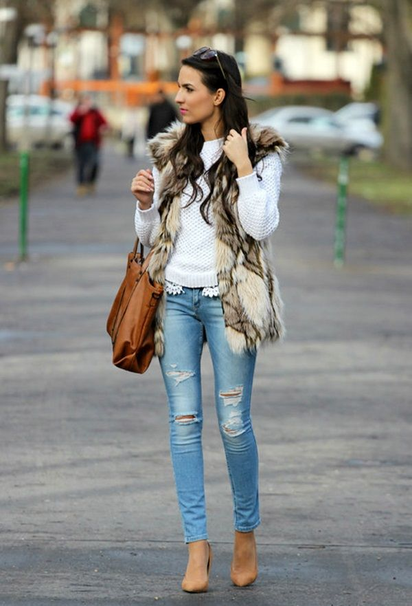 Ripped jeans and fur vest