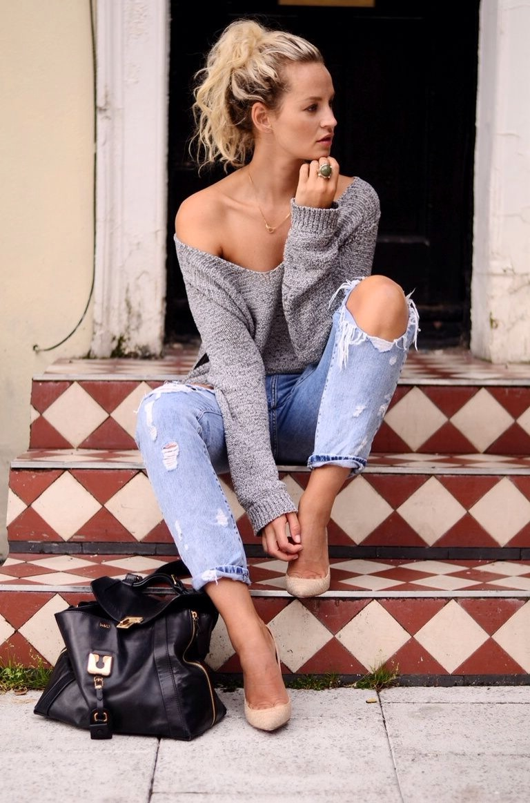 Ripped jeans and sweater