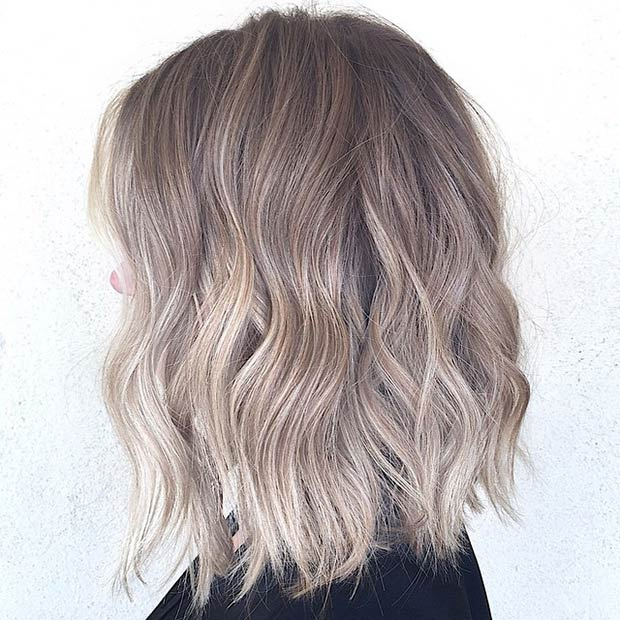 layered brownish blonde lob hairstyle for thick hair