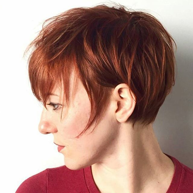 side view of redhead - short messy pixie cut with bangs