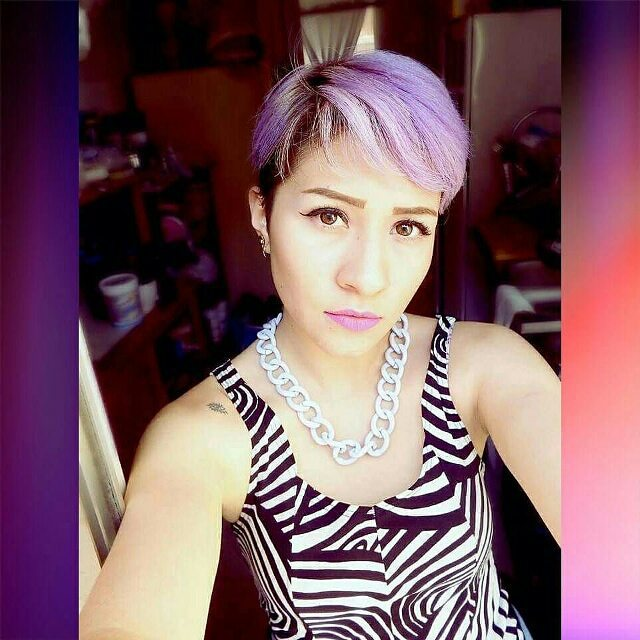 trendy short purple pixie haircut with bangs