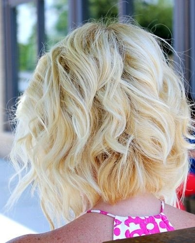 Angled Piecey Bob Haircut with soft curls