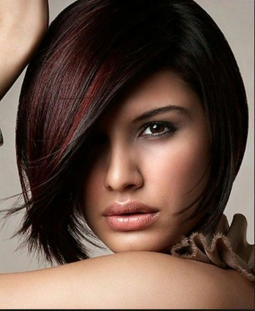 Sleek Bob Haircut with Burgundy Highlights