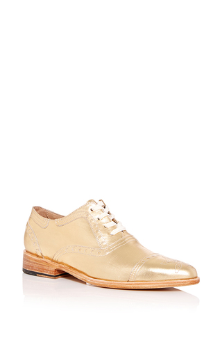 photo of single brogue shoe for ladies, in golden beige